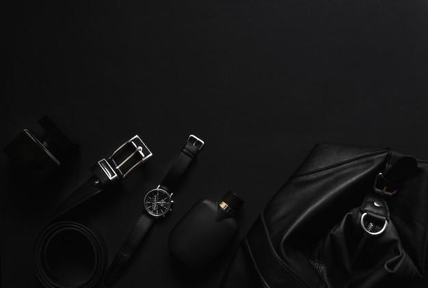 Herrenaccessoires auf schwarzem hintergrund