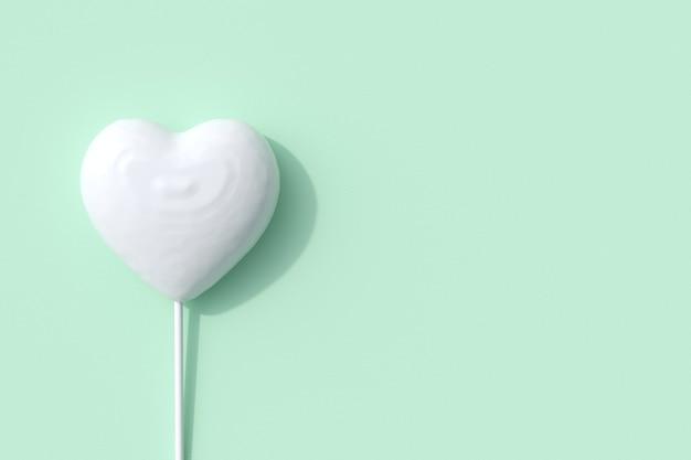 Hervorragende weiße herzform des süßigkeitenlutschers auf grünem hintergrund. 3d-rendering. minimale valentinstag-konzept-idee.