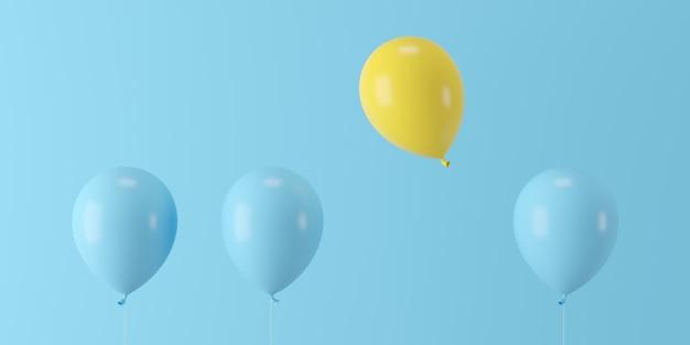 Hervorragender gelber ballon des minimalen konzeptes, der mit blauen ballonen auf blauem hintergrund schwimmt