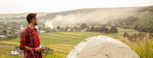 High angle man camping