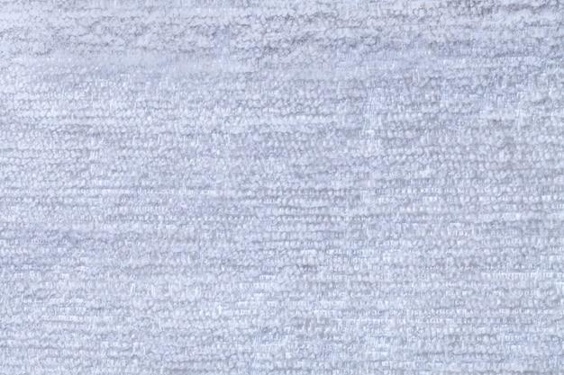 Himmelblauer flaumiger hintergrund des weichen, flaumigen stoffes beschaffenheit des hellen windelgewebes, nahaufnahme