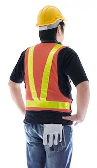 Hintere ansicht des männlichen bauarbeiters mit der standardbauschutzausrüstung lokalisiert
