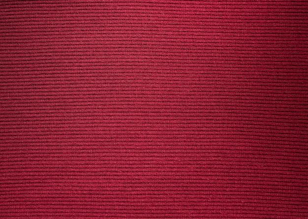 Hintergründe und texturen. kastanienbrauner strickstoff. fein gestrickt.