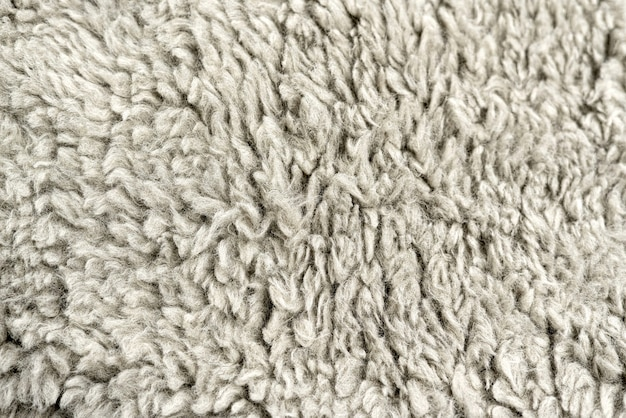 Hintergrund aus wollstoff in einem einfarbigen grauen farbrohling für design