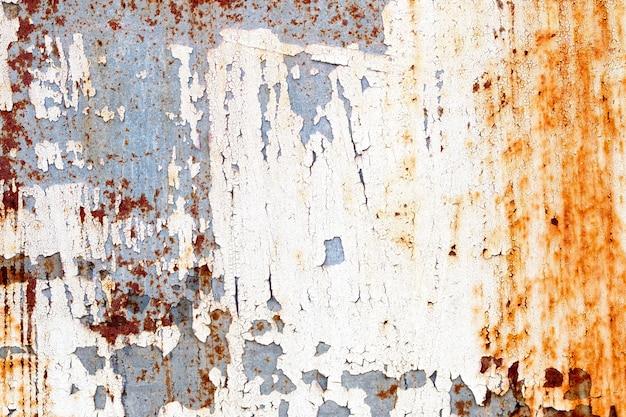 Hintergrund der abblätternden farbe und des rostigen alten metalls