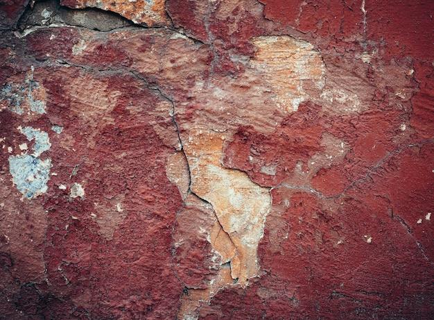 Hintergrund der alten bunten abblätternden farbwand.
