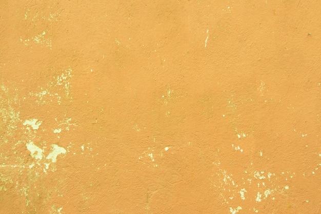 Hintergrund der alten gelben gemalten wand
