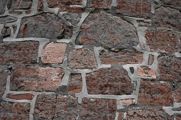 Hintergrund der alten granitsteine mit beton