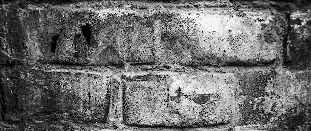 Hintergrund der alten weinlese schmutzigen ziegelmauer mit schälendem gips, textur