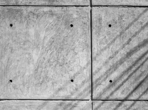 Hintergrund der betonwand-rückwand. graue betonwandbeschaffenheit mit linien und löchern.