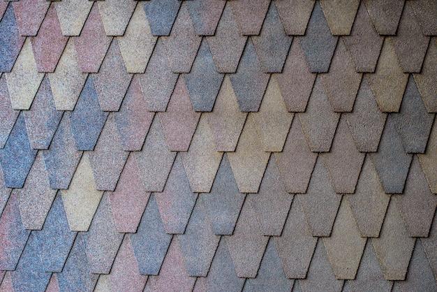 Hintergrund der braunen schindeln auf dem dach Premium Fotos