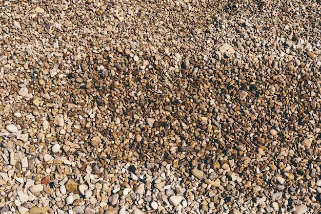 Hintergrund der flusskiesel am strand