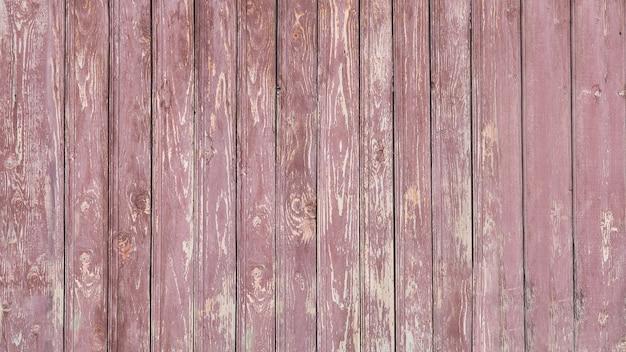 Hintergrund der hölzernen roten alten zaunbeschaffenheit