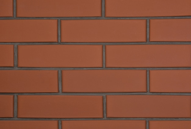 Hintergrund der neuen braunen backsteinmauer. abstrakt.