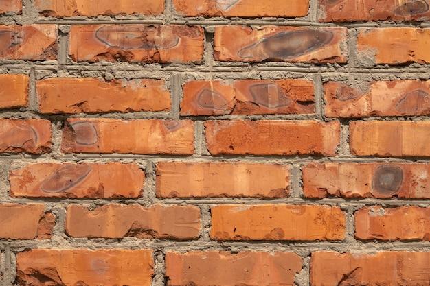 Hintergrund der roten backsteinmauer musterbeschaffenheit. ideal für graffiti-inschriften.