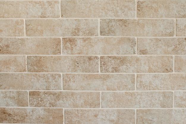 Hintergrund der schmutzigen backsteinmauer der alten weinlese mit schalengips, beschaffenheit