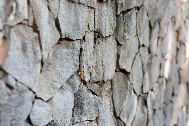 Hintergrund der steinmauer von felsbrocken und kieselsteinen