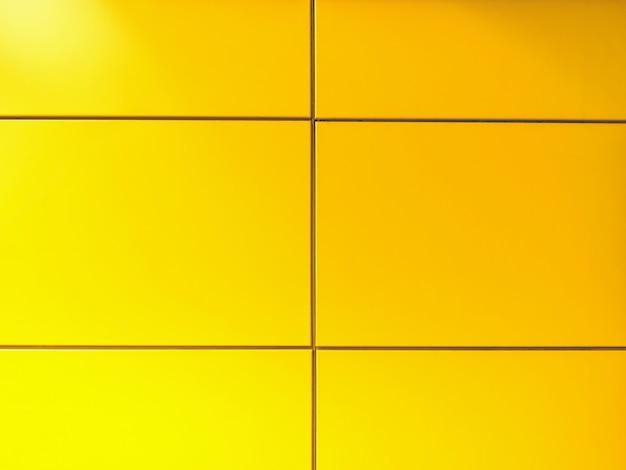Hintergrund der vibrierenden gelben fliesenwand