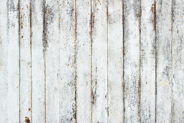 Hintergrund der weißen rostigen metallplanke