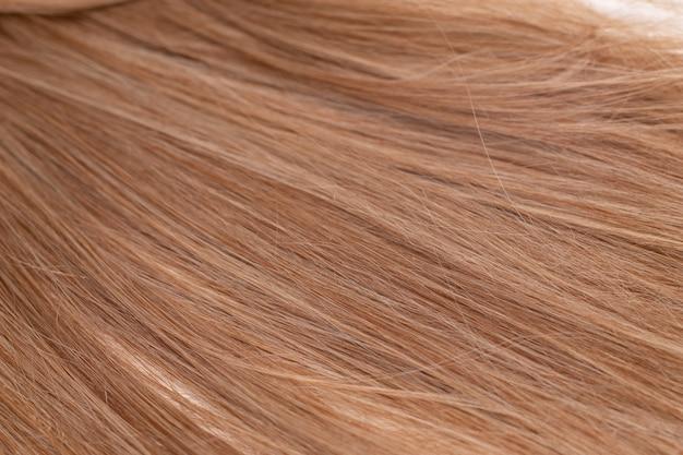 Hintergrund des blonden haares. weibliche blonde haarstruktur