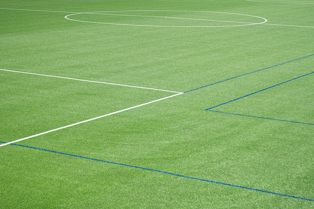 Hintergrund des fußballfeldes mit kunstrasenfeld