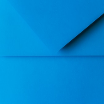 Hintergrund des gefalteten blauen papiers