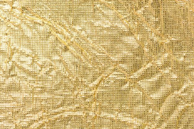 Hintergrund des geknitterten goldenen papiers