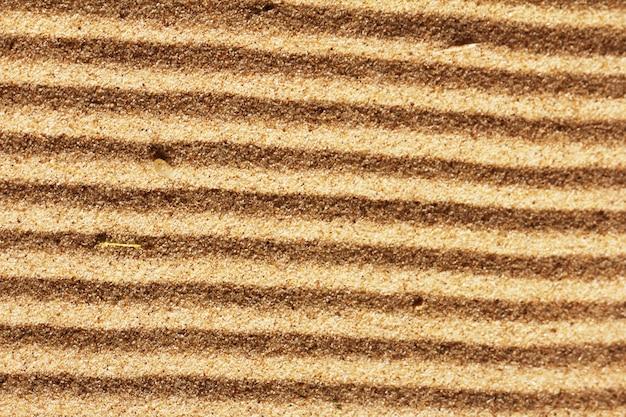 Hintergrund des goldenen sandes