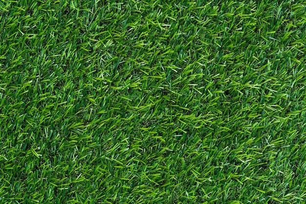 Hintergrund des grünen grases und gemasert