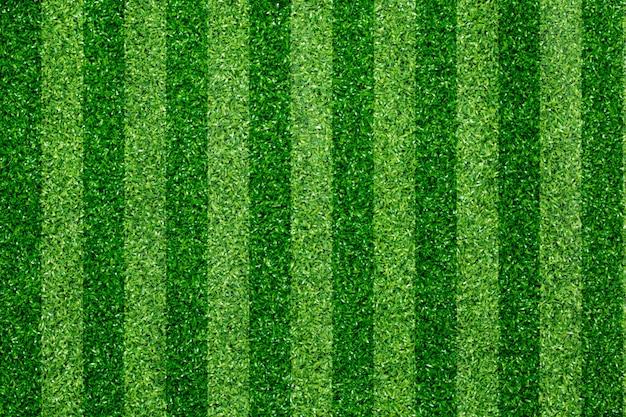 Hintergrund des grünen grasfußballfeldes.