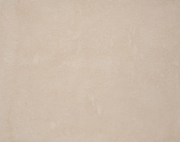 Hintergrund des strukturierten putzes hellbeige. kunsthintergrund