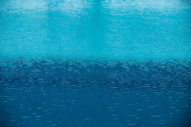 Hintergrund des wassers, blaues oberflächenswimmingpool.