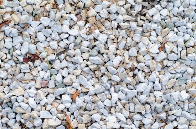 Hintergrund des weißen kieses und des zerquetschten steins