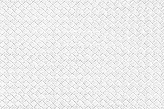 Hintergrund des weißen leders mit nachgemachter webartbeschaffenheit. glänzende kunstlederstruktur.