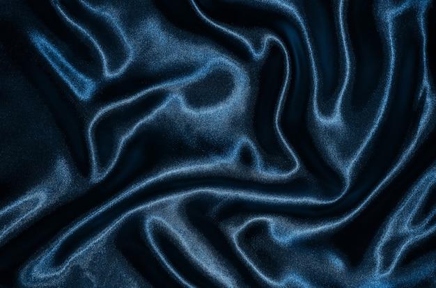 Hintergrund durch blaues gewebe, tapetenbeschaffenheit durch wellenartig bewegendes textilblau.