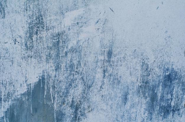 Hintergrund eines blauen stucks beschichtete und malte äußeres