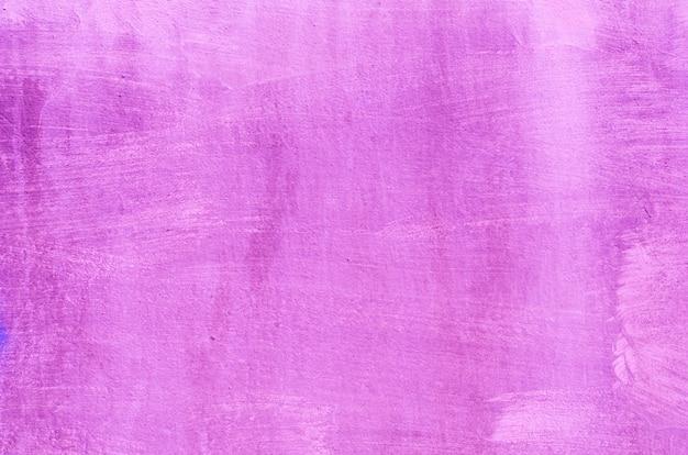 Hintergrund eines dunklen rosa stucks beschichtete und malte äußeres