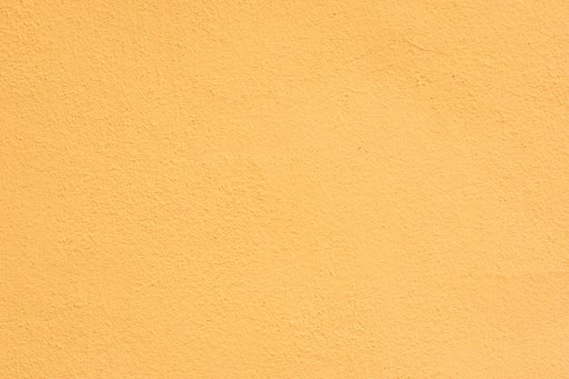 Hintergrund eines gelben stucks beschichtete und malte äußeres