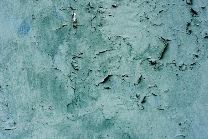 Hintergrund eines mit blauem Stuck beschichteten und bemalten Äußeren, grober Guss aus Zement und Betonwandstruktur