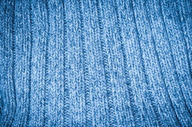 Hintergrund mit blauem gestricktem woolen gewebe