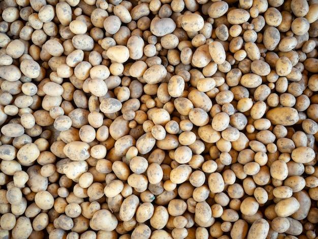 Hintergrund mit kartoffeln, kartoffelbeschaffenheit
