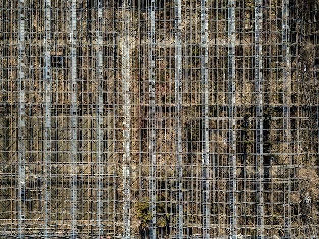 Hintergrund mit rahmen von metallkonstruktionen gewächshäusern vogelperspektive von drohne.