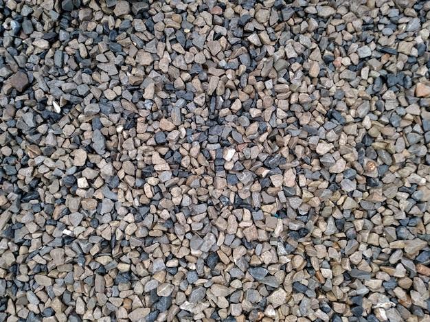 Hintergrund mit verschiedenen kleinen seekieselsteinen