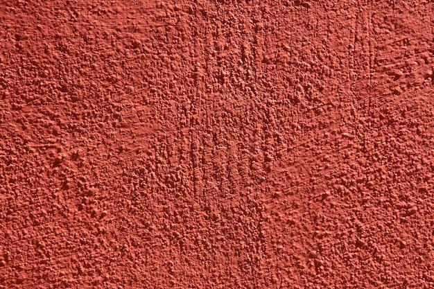 Hintergrund mit wandbeschaffenheit mit roter farbe.