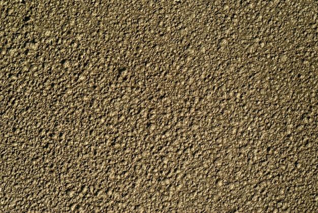 Hintergrund, textur - die mondoberfläche, draufsicht (tatsächlich - nasser ton mit spuren von regentropfen)