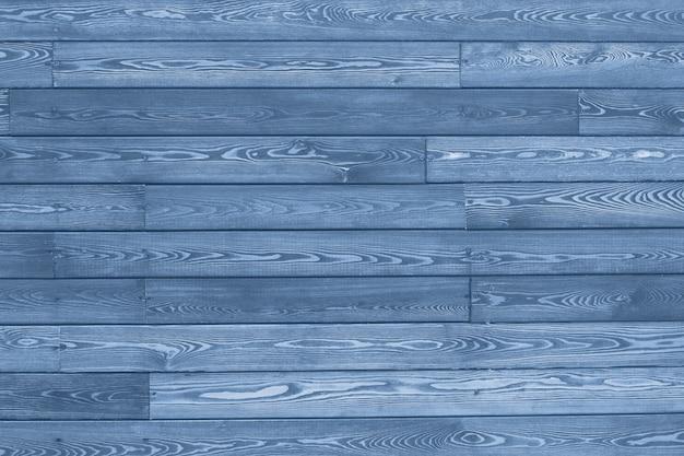 Hintergrund und textur dekorative blaue hölzerne scheunenwand