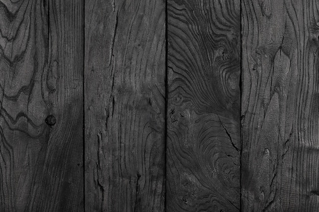 Hintergrund und textur der dekorativen schwarzen holzscheunenwand