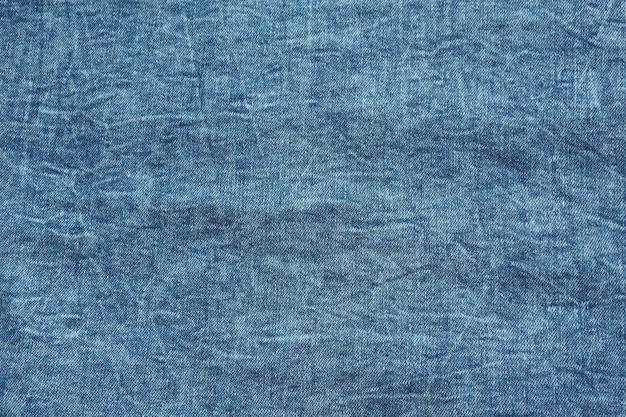 Hintergrund und textur von blauem denim mit kratzern.