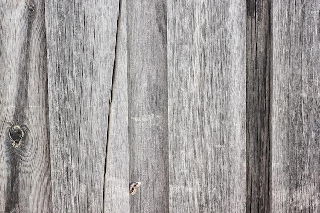 Hintergrund von grauen vertikalen hölzernen brettern