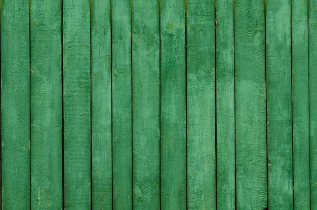 Hintergrund von grünen hölzernen brettern